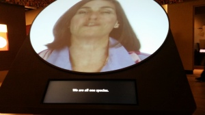 "Hall of Human Origins video of humans speaking the words ""We are all one species"" in a variety of languages."